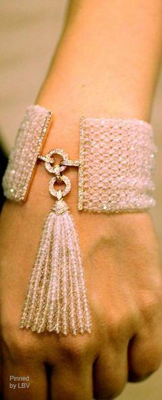 A vivid orange bracelet of carnelian beads set in yellow gold with diamonds with a white tassel cuff | LBV ♥✤ | BeStayBeautiful