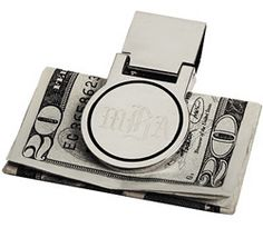 "Silver Money Clip Size: 2.25""L x 1.25""W Give the gift of elegance with our Personalized Modern Silver Money Clip. The unique design of this money clip gives it an air distinction. It is crafted in a sleek silver finish and displays a round center plate which can be engraved for an added personal touch. This modern money clip holds bills securely and in style and is slim enough to fit inside any pocket. The Personalized Modern Silver Money Clip is the perfect gift for anyone who…"