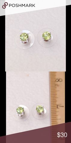 Peridot Stud Earrings 1.06 CTs Square cut Peridot stud earrings. Done in .925 Sterling Silver Nickel Free with surgical steel posts. 1.06 CTs. Jewelry Earrings
