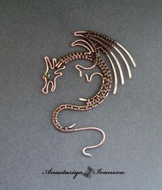 Wire wrapped dragon. Excellent as a scarf pin, necklace or if  using larger gauge wire... as a wall decoration.