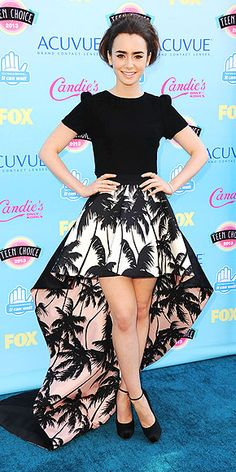 Lily Collins in high-low Fausto Puglisi skirt and black Houghton top at the Teen Choice Awards