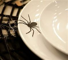Surprise your Halloween dinner guests with these vinyl spiders!