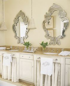 His and hers sinks with Venetian mirrors, skirted sinks, monogrammed towels and pleated fabric pendant lights - Norman Davenport Askins Architect   Atlanta, GA