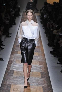 Sleek black leather skirt softened up with sheer white top by #Valentino RTW Fall 2012 - Runway, Fashion Week, Reviews and Slideshows - WWD.com  (Photo: Giovanni Giannoni)
