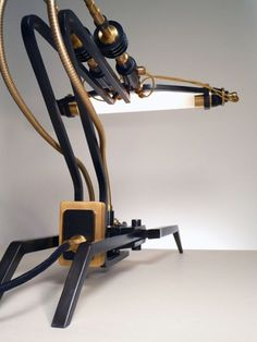 TYPE 11 BY FRANK BUCHWALD  | Designer and Manufacturer:  Frank Buchwald (Germany)    | Material:  Burnished steel brushed brass, textile cables, flexible brass tubes |    Size:  42cm x 40cm   | Price:  9,800 CHF