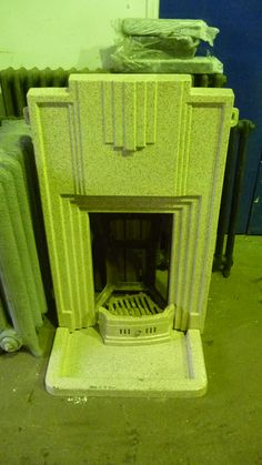 Art Deco fireplace covered in enamel.Brought into us for restoration.