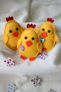 Three little Easter chicks These adorable little chicks are entirely hand stitched with hours of work and love! You can choose body colors based on my current stock of felt (which is pretty large,lol). Every chick is slightly different. This set will make