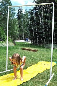 PVC sprinkler! Drill holes and attach to hose.Awesome idea to put over a slip and slide this summer!!