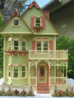 Lovely lime green and red dollhouse.