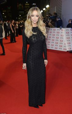Black to basics: The Only Way Is Essex star Lauren Pope made with a racy display as she arrived in a long-sleeved semi-sheer gown