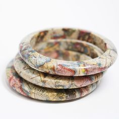 Wood bangles decoupaged with map pieces.
