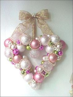 Christmas wreath idea: Beautiful Heart shaped wreath made from Christmas bulbs!  This does not have a tutorial but @abbey Phillips Regan Truax://enchantedrosestudio.blogspot.com/ you will find so many wonderful tutorials on other wreaths & lots of great projects!!!  I would love to someday make one like this for my home. <3