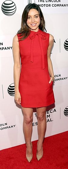 Aubrey Plaza wears a red Valentino dress with a bow on the collar, and nude-colored Louboutins at the Tribeca Film Festival