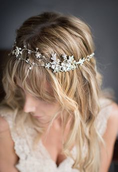 This beautiful wire hair vine, hair wrap, flower crown available in Rose Gold, Gold or Silver tone, is a lovely finishing touch for the boho chic bride. A mix of white and ivory imitation pearls with crystals are set on two wires that criss-cross with metal flower accents. A metal flower and leaf focal piece is located on one side with delicate single beaded wires tapering to the end. Measures approx. 14.25L x 1 5/8 at the widest piece.  Ties are easily removed - (pulled through two wire…