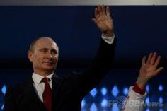 フィシュト五輪スタジアム(Fisht Olympic Stadium)で行われたソチ冬季パラリンピック閉会式に出席するロシアのウラジーミル・プーチン(Vladimir Putin)大統領(2014年3月16日撮影)。(c)AFP/KIRILL KUDRYAVTSEV ▼17Mar2014AFP ソチ冬季パラリンピックが閉幕 http://www.afpbb.com/articles/-/3010425 #Sochi2014 #Paralympic