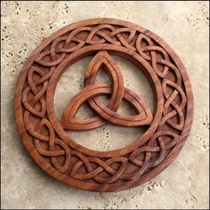 Trinity Knot Celtic Circle Wood Carving is made out mahogany and polished with a special wax which will last a lifetime. Celtic knots are perhaps the most identifiable of all. The strands that made up a knot were intertwined with one another which symbolized protection and unity. It is also said to symbolize how everything is interconnected. - See more at: http://www.irishongrand.com/gifts/for-home/for-wall/bf/trinity-knot-celtic-circle-wood-carving-pid-26474#sthash.E530T2XT.dpuf