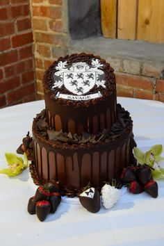 Family crest groom's chocolate cake at Megan & Brody – ArtSpace 111 Fort Worth Wedding Pictures » | Dallas-Fort Worth Wedding Photographer