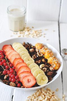 Homemade cacao-granola with fresh fruit and banana-vanilla milk. Put it over Greek Yogurt for a deliciously healthy breakfast!