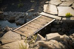 Build a Bridge From Reclaimed Materials Like the One at Blog Cabin >> http://www.diynetwork.com/how-to/outdoors/hardscape/how-to-build-a-bridge-from-reclaimed-materials?soc=pinterestbc15