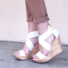"""Diane von Furstenberg Opal Wedge Heel in White These DVF cross strap heels feature a wooden wedge and back zip closure. Leather upper with rubber sole. Wedge measures approx 4.5"""" and platform measures approx 1.25"""" in height. Worn only a few times, in great condition with just a few scuffs on the upper and sole. Includes box and dust bag. No trades but will accept best offer. Diane von Furstenberg Shoes Wedges"""