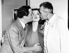 """William Powell and director W. """"Woody"""" Van Dyke give Myrna Loy a smooch on the set of Another Thin Man Thin Man Movies, Old Movies, Vintage Hollywood, Classic Hollywood, Jeanette Macdonald, Nick And Nora, William Powell, Esther Williams, Tv Awards"""