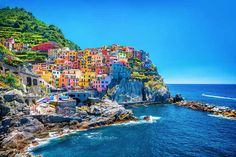 Manarola, Cinque Terre, Italy! Click through to see some of the most colorful cities in the world! This post does not contain industrial soot stained cities; instead it showcases some of the most vibrant looking cities in the world.