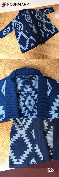 BCBG MAXAZRIA Sweater Cardigan Adorable Navy Blue and Taupe Aztec lightweight sweater Cardigan from BCBG MAXAZRIA. Very good pre owned condition, no stains or flaws. Minor pilling from normal wear-super soft and cozy Cardigan! BCBGMaxAzria Sweaters Cardigans