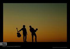Dans la rue - Pinned by Mak Khalaf Playing in the sun Performing Arts backlightguitarmusicmusiciansilhouettesunset by Ellebierre