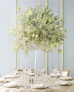 Mix inexpensive blooms like miniature daisies, doily-shaped Queen Anne's lace, and baby's breath to create a show-stopping centerpiece.LOVE!!!