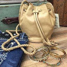 """Lucky Brand Desert Sun Mini Bucket Crossbody Bag So cute! A mini bucket bag made of premium leather in desert sun color. Gorgeous leather braided straps. This urban boho style bucket bag will add a hipster style to any outfit. Features a classic silhouette, interior pockets and intricate braided detailing.  It is a mini bucket- Approx 7"""" long x 7"""" high x 5"""" wide- 25"""" adjustable crossbody strap. Brand new with tags! Retails $98 Lucky Brand Bags Crossbody Bags"""
