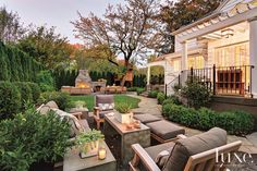 A modernized Colonial revival home's outdoor seating area. See more at www.luxesource.com. #luxe #luxemag #luxury #design #interiordesign #interiors #home #house #dwelling #residential #decor #homedecor #interiordecorating #interiordesignideas #architecture
