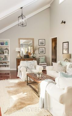 You have to see this #farmhouse living room decor idea with a cowhide rug. Love it! #HomeDecorIdeas #LivingRoomIdeas