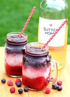 red white and blue wine slushies with raspberries and blueberries