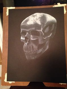 """""""Finished"""" Skull in white charcoal on black paper. Art 101, Dec 2013"""