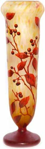 Cameo vase by Daum Nancy with footed cylindrical form in mottled yellow and rose coloured glass, decorated with crimson and gray berries on burgundy leafy branches. 16 1/2""