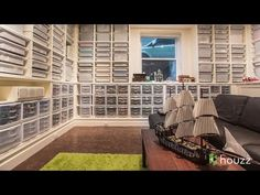 This Seattle architect saved all his Legos as a child and now they are stored in 153 bins in his basement remodel, family room! The 250,000+ pieces are sorted by color and type in 3 walls of custom built shelves that house storage in Ikea bins and Sterilite drawers. The room also serves as a media room with a screen that drops down in front of one of the bookshelves.