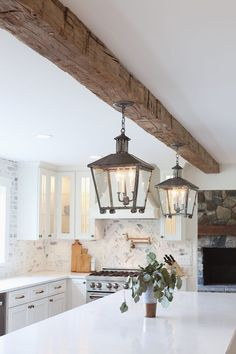 Gorgeous pendant lights and rustic beam in this farmhouse kitchen. all white kitchen with reclaimed wood beam from real antique wood - lindsay marcella design Küchen Design, House Design, Design Ideas, Wooden Beams Ceiling, Wood Beamed Ceilings, Wood On Ceiling Ideas, Ceiling Wood Design, Vaulted Ceiling Decor, Plank Ceiling