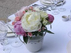 Peonies and wild branch roses. Created in July by the Chateau de Lartigolle.