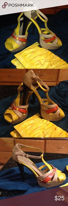 """Tan/Orange/Yellow Stilettos Size 8 Has a small scratch & scuff on right heel see pic. Buckles on the side. 5"""" heel. Shoes Heels"""