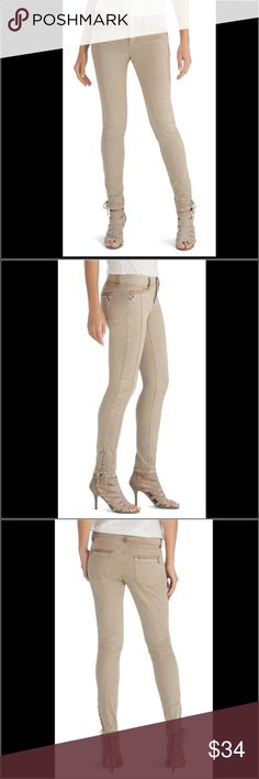 WHBM EMBELLISHED MOTO SKINNY JEAN Brand new never worn skinny jeans with motocross-seaming and stitching. Silvertone studs and crystal embellishments.  Our straight fit. Straight through the hip and thigh, features a low rise, and sits lower on the waist. Skinny leg. Rhinestone embellished goldtone button shank with zip fly front closure. Belt loops. Lace up design at hem. Silvertone and rhinestone embellishments on front and back pockets.  94% cotton, 4% polyester, 2% spandex. Hand wash…