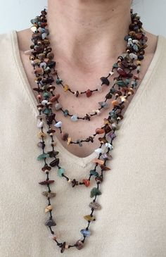 Lovely! What a necklace... Lots of stones in earthy natural colors.  $30 https://www.etsy.com/listing/220223155/multistrand-stone-necklace-with-earthy?ref=related-3