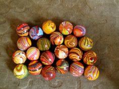 These vintage Italian marbles would be a wonderful accent piled into a pretty gold dish. I love marbles.
