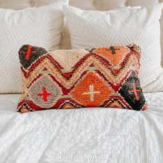 One-of-a-kind Moroccan kilim pillow made from vintage rugs. This pillow features a different pattern on each side. Boho Throw Pillow. Lucky Collective Textiles #LuckyCollective