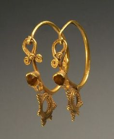 PAIR OF LATE ROMAN OR EARLY BYZANTINE GOLD EAR PENDANTS    Inverted volutes over bezel; stationary beaded pendant on wire loop.    5th-6th Century AD by cathy