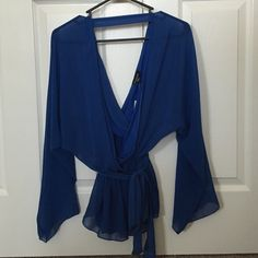 Blue Surplus kimono sleeve wrap tunic NWT in excellent condition. May fit up to xsmall. bebe Tops