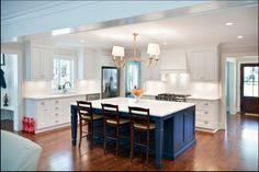 I love the blue island, gold lighting, pulls on the cabinets