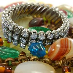 Rhinestones, beads and other vintage jewels....timeless and beautiful design. www.banglesbeadsnbags.etsy.com