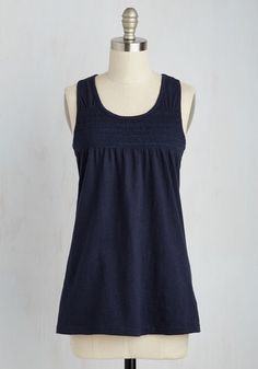 Before topping this navy blue tank top with an apron and getting to work, sit down to chart out what types of confections you'll concoct. With a cool racerback and cute smocking at the chest, this shirt may just be the one you wear to sell your sweets, as well!
