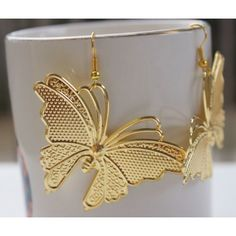 Very pretty earrings with golden butterflies flying away to glory:) The golden butterflies are simply alluring ,very modern & stylish!