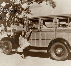 Mrs. Coig's woodie picking up children to go to Calabasas School, circa 1930s. Pictured is Sally Cooper next to the bus. San Fernando Valley History Digital Library.